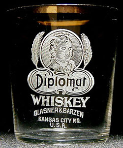 A rare John Jay Diplomat Whiskey shot glass, from Glazner & Barzen of Kansas City, MO.