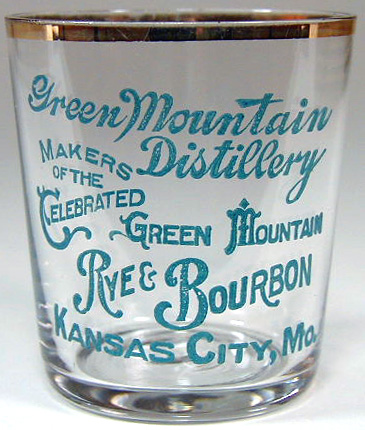 Green Mountain Distillery shot glass with a blue-green label.